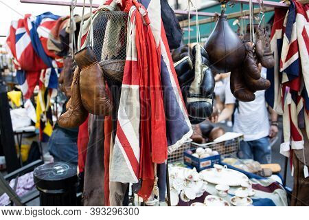 Flags Of United Kingdom, Old Boxing Gloves And Antique Objects On A Stand Of A Flea Market