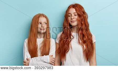 Ginger Family. Redhead Beautiful Sisters With Freckled Skin, Gentle Smiles, Look At Each Other, Cant