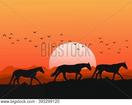 The Silhouette Of A Herd Of Horses On The Hills At Sunset Has Mountains And Orange Sky As Background