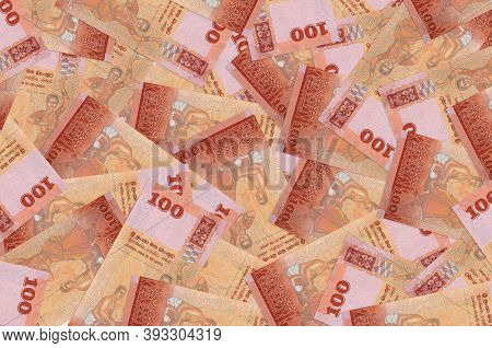 100 Sri Lankan Rupees Bills Lies In Big Pile. Rich Life Conceptual Background