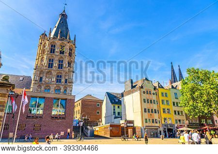 Cologne, Germany, August 23, 2019: City Hall Rathaus Tower With Spire And Clock And Colorful Buildin