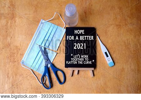 Hope For A Better 2021, Let's Work Together To Flatten The Curve Written On Chalkboard With Backgrou