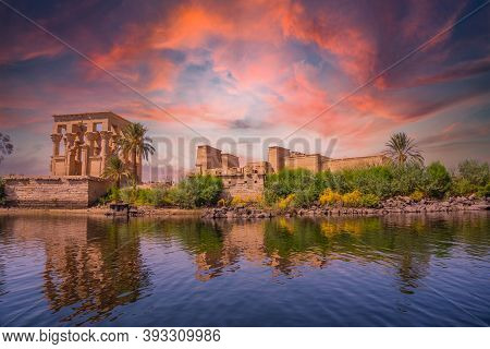 Incredible Orange Sunrise At The Temple Of Philae, A Greco-roman Construction Seen From The Nile Riv