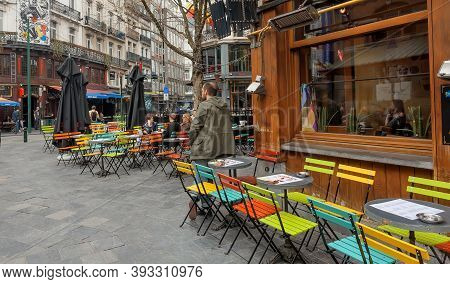 Brussels, Belgium: Street Cafe Chairs And Some Visitors In Old City Area, Historical District With R