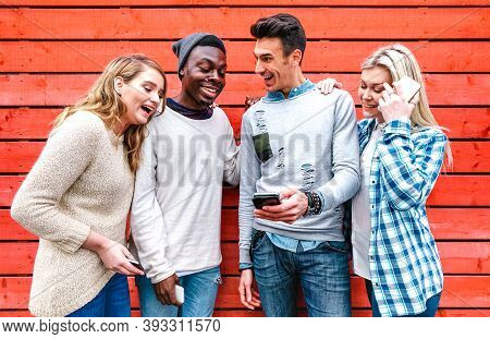 Millenial Best Friends Using Smart Phone At Urban City Area - Technology And Friendship Concept With
