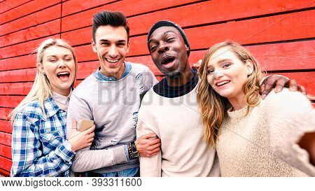 Happy Multiracial Friends Taking Group Selfie At Red Wood Background - Millenial People Sharing Fun