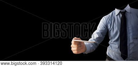 Shot Of A Well Dressed Employee Holding An Smartphone In His Hand Isolated On Black Background.