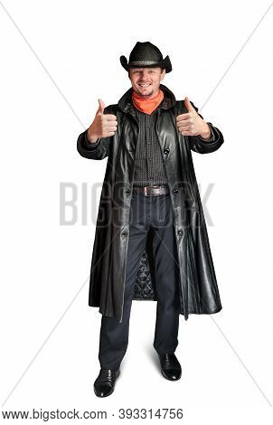 Cowboy In A Leather Coat Shows A Gesture With His Hands. Unshaven Smiling Man In A Hat. Macho Guy On