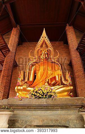 Stunning Golden Buddha Statue In Yellow Robe At The Ordination Hall Of Wat Yai Chai Mongkhon Temple,