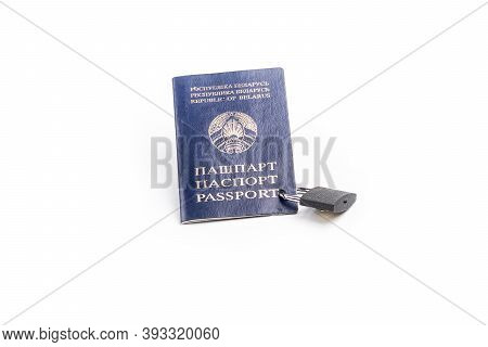 Studio Lighting. The Citizen's Passport Is Tied With A Metal Chain In The Center With A Yellow Lock.