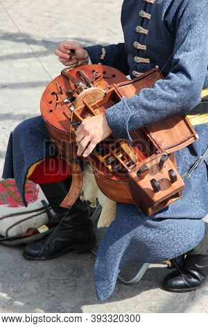 Budapest, Hungary - June 20, 2014: Street Performer Plays Hurdy Gurdy Folk Music In Budapest. Hurdy-