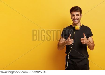 Yeah, I Like This Music. Positive Hipster Gives Thumbs Up, Shows Like Gesture, Expresses Good Emotio