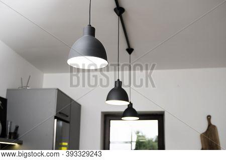 Industrial Black Look Pendant Lamps In A Kitchen Interior. Modern Loft Interior Design.