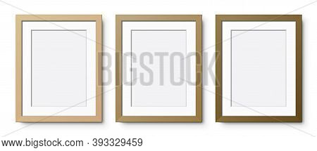 Set Of Vertical Wooden Frames With Passepartout, In Different Shades Of Color, Hanging On A White Wa