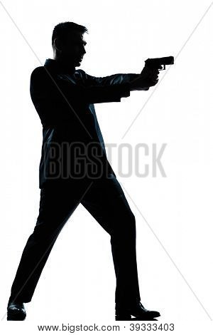 one caucasian  spy criminal policeman detective man aiming shooting gun  full length silhouette in studio isolated white background poster