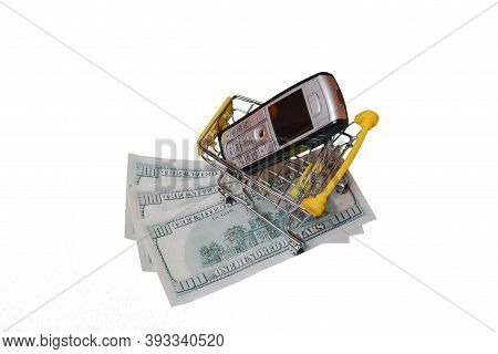Shopping Cart Trolley With Mobile Phone. Supermarket Trolley Filled With Old Cell Phones Representin