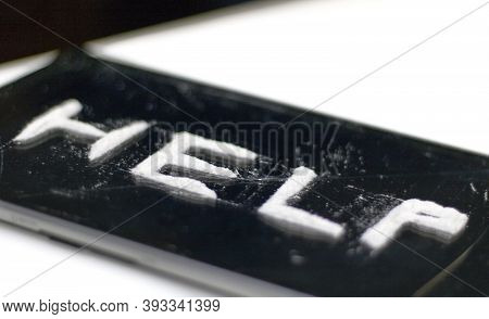 Perspective Image Of A Call For Help, On A Dark, Broken Glass Surface, Written By A Cocaine Addict,