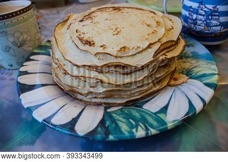 Stack Of Traditional Russian Pancakes Blini On Gray Background With Copy Space. Homemade Russian Thi