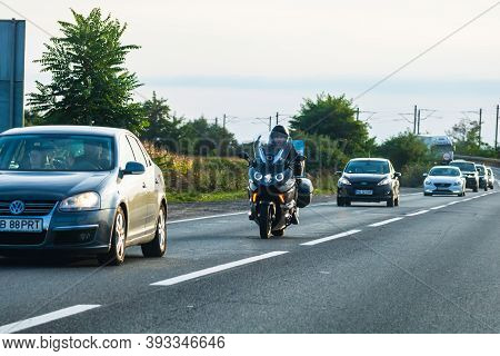 Traveling Motorcycle In Motion On Asphalt Road, Front View Of Motorcycle On Street In Traffic. Bucha