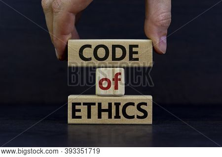 Male Hand Placing A Block With Word 'code' On Blocks Tower With Words 'code Of Ethics'. Beautiful Da