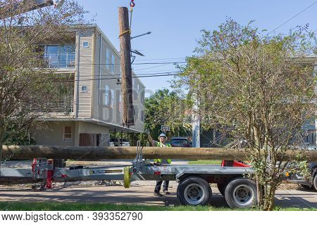 New Orleans, La - October 31: Utility Company Worker Receives A Damaged Utility Pole While Making Re