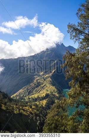 Mountains And Green Phosphor River, Landscape With Clouds In The Morning, Beautiful Volcano Rinjani
