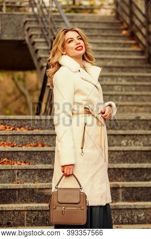 Finally Here. Girl Warm Coat Stairs Background. Faux Fur Coat Fashion. Stylish Business Lady Leather