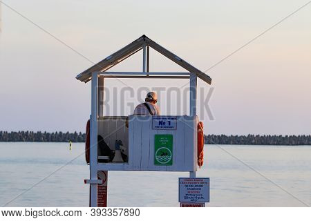 Sochi, Russia - June 09, 2019: A Lifeguard Sitting On Surveillance Tower In Front Of The Sea, Beach