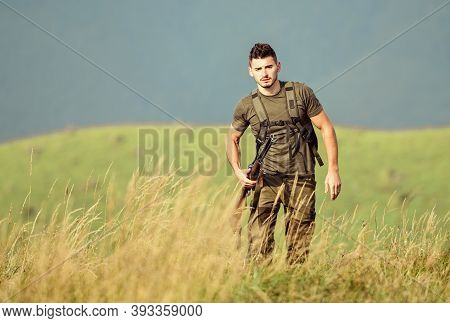 Action Target. Man Hold Weapon. Soldier In The Field. Polygon. Military Style. Male In Camouflage. A