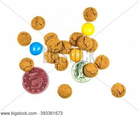Bunch Of Pepernoten Cookies, Sweets And Chocolate Money From Above On White Background For Annual Si