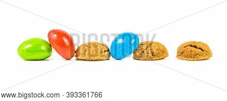 Pepernoten Bunch Of Traditional And Colored Cookies On White Background For Annual Sinterklaas Holid