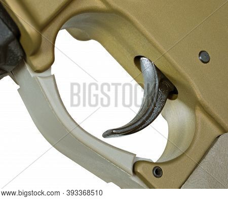 Trigger On A Bronze Colored Ar-15 On A White Background