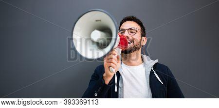 Man Hand Holding Megaphone. Attention Loud Shout