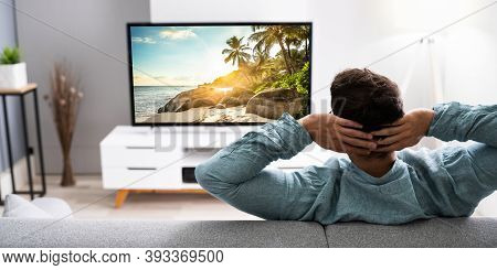 Watching Tv Movie On Couch In Living Room