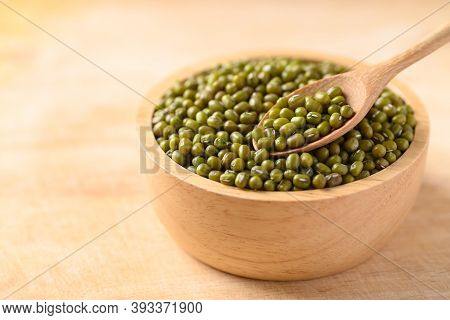 Mung Bean With Spoon In A Bowl On Wooden Background