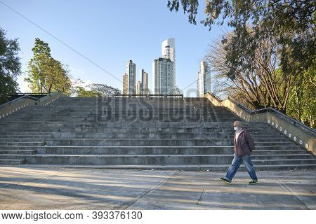 Caba, Buenos Aires / Argentina; Nov 4, 2020: Man Walking Through A Park In Puerto Madero Wearing A F
