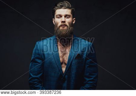 Bearded And Mature Businessman Posing In Blue Suite With Stylish Haircut And Serious Face In Dark Ba