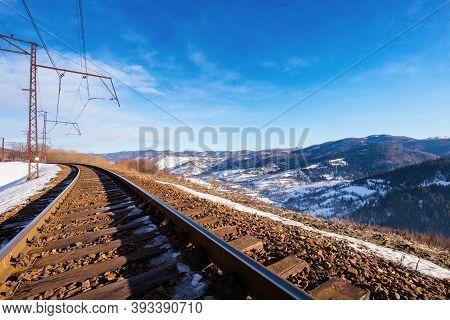 Railroad In Mountains. Frosty Winter Landscape. Transportation Scenery