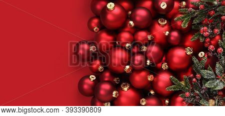 Christmas Decorations, Top View Of Pile Of Glass Balls Colored In Red And Mistletoe, Isolated On Red