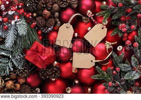 Merry Christmas Background, Top View Of Composition With Red Balls , Mistletoe, Pine Cone And Tag La