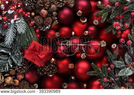 Merry Christmas Background, Top View Of Composition With Red Balls , Spectacles, Mistletoe And Pine