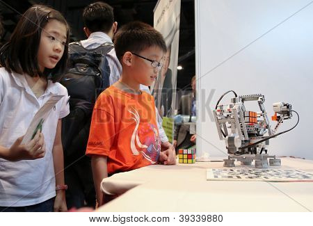 SUBANG JAYA - NOVEMBER 10: An intelligent robotic hand solves a Rubic cube puzzle for unidentified visitors at the World Robot Olympaid on November 10, 2012 in Subang Jaya, Malaysia.