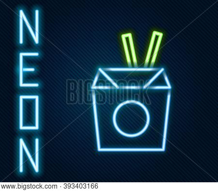 Glowing Neon Line Asian Noodles In Paper Box And Chopsticks Icon Isolated On Black Background. Stree