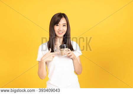 Happy Asian Young Woman Wearing White T-shirt Standing And Holding A Coffee Happy, Smiling And Cheer