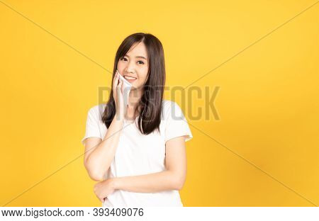 Asian Young Woman Wearing White T-shirt Standing And Holding A Tissue Paper On Her Face Female With