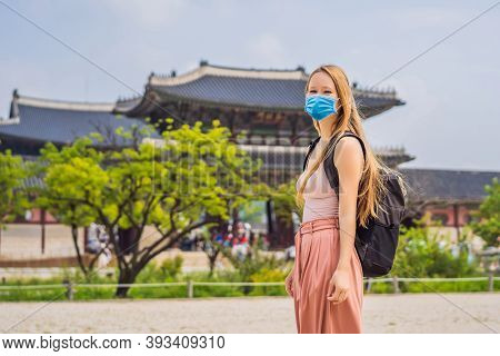Woman Tourist Wearing A Medical Mask During Covid-19 Coronavirus In Korea. Gyeongbokgung Palace Grou