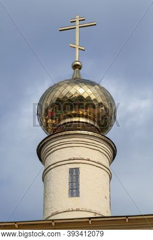 Golden Cupola With Cross Of Tikhvin Cathedral Of Dormition. Russia