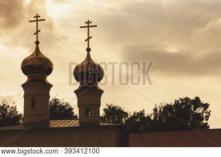 Silhouette Photo Of Golden Cupola Of Tikhvin Cathedral Of Dormition At Evening. Russia