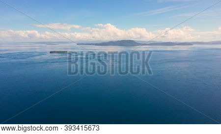 Seascape With Blue Sea And Islands.sea Against A Blue Sky With Clouds. Mindanao, Philippines.
