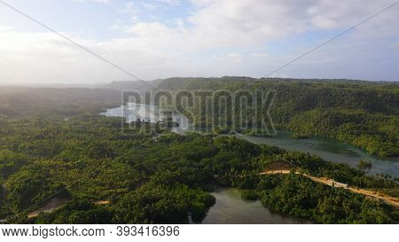A Rainforest With A River Among Green Hills And Mountains, Aerial View . Philippines, Mindanao.